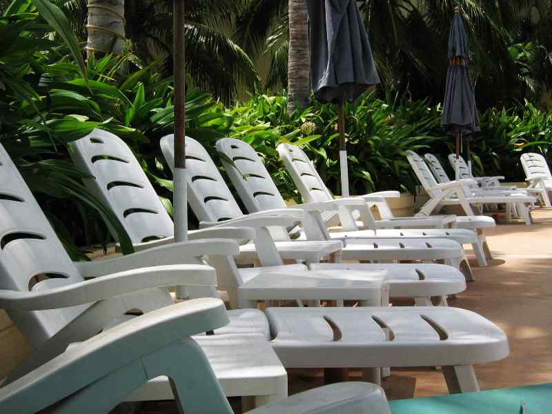 Line of chairs beside swimming pool